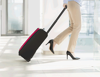 Women business traveller with luggage